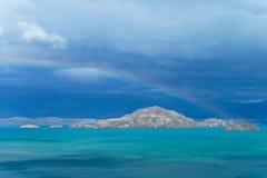 Beautiful blue water and rocks lake coast stock photos