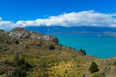 Beautiful blue water and rocks lake coast royalty free stock photos