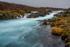 Beautiful blue waterfall in autumn of Iceland Stock Images