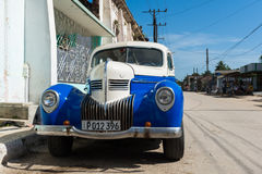 Beautiful blue white classic car parked in Cuba Stock Photo