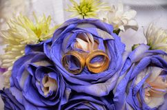 Blue wedding bouquet and rings. Beautiful blue and white fresh flowers wedding bouquet Royalty Free Stock Photography