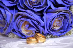 Blue wedding bouquet and rings. Beautiful blue and white fresh flowers wedding bouquet. Beautiful blue and white fresh flowers wedding bouquet Stock Image