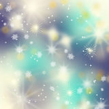 Beautiful blue winter background. With snowflakes Stock Images