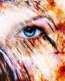 Beautiful blue women eye beaming, color feathers effect, painting collage, phoenix makeup Royalty Free Stock Photo