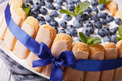 Beautiful blueberry cake with cookies Savoiardi macro. horizonta Stock Photos