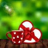 Beautiful blur Valentine`s background with mug and gift Stock Image