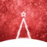Beautiful blurry bright Christmas tree on red snowy background Royalty Free Stock Photography