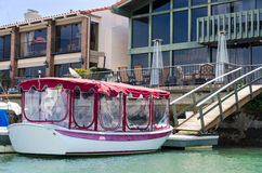Beautiful boat and home Royalty Free Stock Images