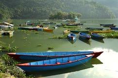 Beautiful boats in Phewa lake Stock Images