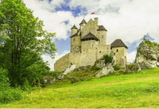 Beautiful Bobolice castle in spring time, Poland. Panorama of ruins of the Polish castle in Bobolice Royalty Free Stock Photo
