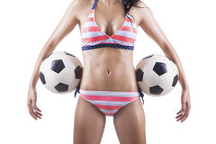 Beautiful body of female soccer fan in bikini Stock Photos