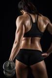 Beautiful body of  fitness female. Dark background Stock Photos