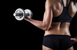 Beautiful body of  fitness female. Dark background Royalty Free Stock Photography