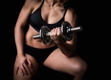 Beautiful body of  fitness female. Dark background Stock Photo