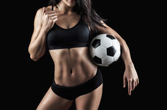 Beautiful body of fitness model holding soccer ball Stock Image