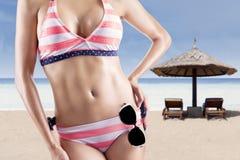 Beautiful body in sexy bikini at beach 1. Beautiful body in sexy swimsuit at beach Royalty Free Stock Photography