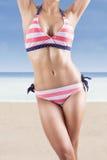Beautiful body in sexy bikini at beach. Beautiful body in sexy swimsuit at beach Royalty Free Stock Image