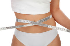 Beautiful body woman measuring her waist Royalty Free Stock Image
