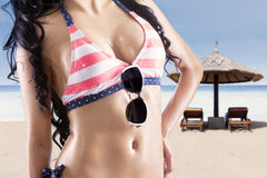 Beautiful body woman with sunglasses. Beautiful body in sexy swimsuit at beach Royalty Free Stock Images