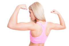 Beautiful bodybuilder girl flexing arms Stock Image