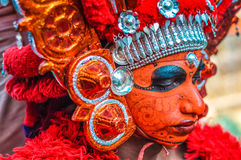 Beautiful bodypaint in Kerala. Thottada, south of Kannur, Kerala - circa January 2012: Photo of beautiful and artistic mask of young ritual dancer at Theyyam Royalty Free Stock Images