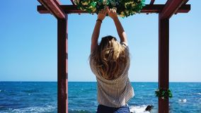 Beautiful bohemian styled and tanned girl at the beach. Against the backdrop of sea waves stock photos