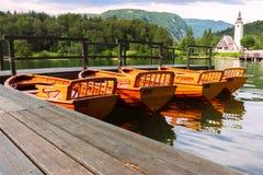 Beautiful Bohinj lake. Slovenia. Bohinj Lake with boats and Church near Ribcev Laz, Julian Alps, Slovenia Stock Photos