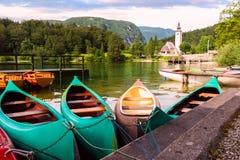 Beautiful Bohinj lake. Slovenia. Bohinj Lake with boats and Church near Ribcev Laz, Julian Alps, Slovenia Royalty Free Stock Photos