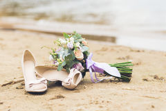 Beautiful boho composition with a bridal bouquet and wedding shoes Royalty Free Stock Image