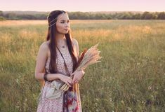 Beautiful boho girl standing in the field royalty free stock images