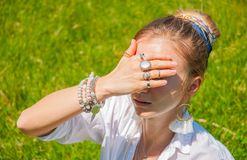 Beautiful boho style woman with accessories enjoy summer sunny day in park. Female hands with bracelets and rings royalty free stock image