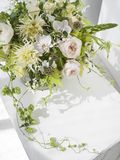 Wedding flower bouquet. Beautiful boho wedding flowers bouquet.  Green hops, yellow chrysanthemum and pastel pink roses Royalty Free Stock Images