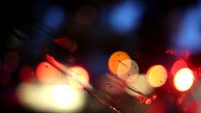 Bokeh night city in the rain. Beautiful bokeh, blurs from the rainy night city from the car window stock footage