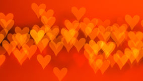 Beautiful bokeh of lights on defocused background in a form of hearts Royalty Free Stock Photo
