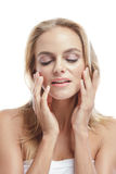 Beautiful bolnde woman touching her smooth skin face Royalty Free Stock Photos