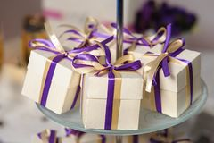 Beautiful bonbonnieres with ribbons staying in a row. royalty free stock photography
