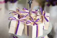 Beautiful bonbonnieres with ribbons staying in a row. stock photos