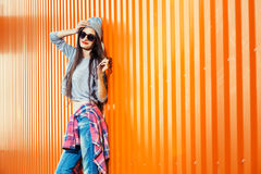 Beautiful Bool Girl over orange Wall Stock Images