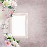 Beautiful border with flowers, frame and wedding rings on a vintage background Royalty Free Stock Photos