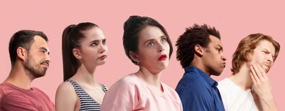 Beautiful bored people bored on pink background royalty free stock images