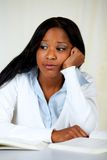 Beautiful boring black woman studying Stock Photography