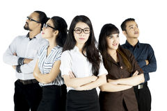 Beautiful boss standing with her colleagues Stock Image