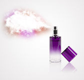Beautiful bottle spraying colorful cloud Stock Photo
