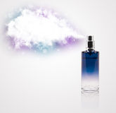 Beautiful bottle spraying colorful cloud Stock Photos