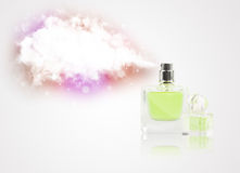 Beautiful bottle spraying colorful cloud Royalty Free Stock Image