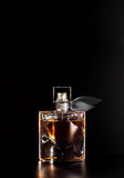 Beautiful bottle of women`s perfume. On a black background Stock Images