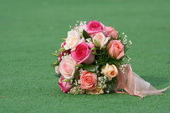 Beautiful bouquet. The beautiful bouquet of roses lays on a grass Stock Photography