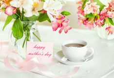 Beautiful bouquet of alstroemeria and cup of tea for mother's da Royalty Free Stock Photos