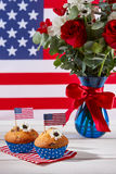 Beautiful bouquet with american flag and cupcakes. Beautiful bouquet with american flag and cute cupcakes Stock Images