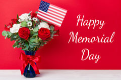 Beautiful bouquet with american flag on red background Royalty Free Stock Images